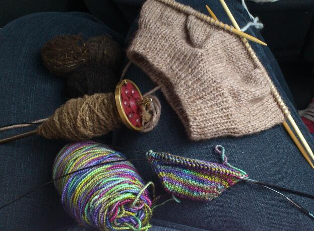 Knitting and spinning works in progress Ethical Twist Koigu hebridean and manx sheep wool on spindle