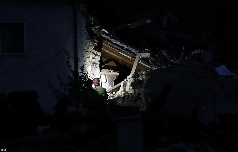 Volunteers had to light up the collapsed buildings as they continued a desperate search for survivors in the town of Pescara Del Tronto