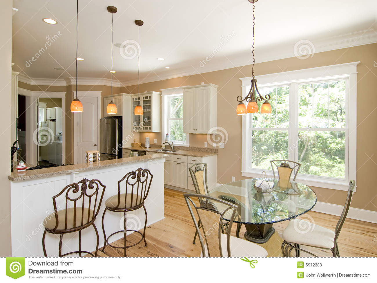 Upscale Kitchen And Dining Room Royalty Free Stock Photos - Image