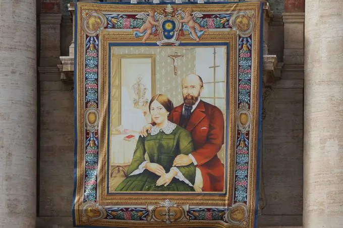 A tapestry of Blessed Louis and Zelie Martin, parents of St. Therese of Lisieux, hanging in St. Peters Square Oct. 16, 2015, in preparation for their canonization on Sunday. Credit: Daniel Ibanez/CNA.