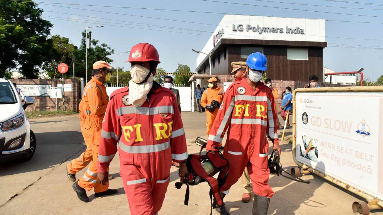 Firefighters walk with oxygen cylinders outside LG Polymers plant, the site of a chemical gas leak, in Vishakhapatnam, India, Thursday, May 7, 2020. Synthetic chemical styrene leaked from the industrial plant in southern India early Thursday, leaving people struggling to breathe and collapsing in the streets as they tried to flee. Administrator Vinay Chand said several people fainted on the road and were rushed to a hospital. Image credit: AP Photo