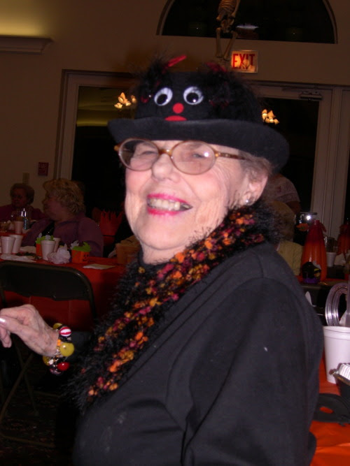 "Here is Gloria dancing at a Halloween party several years back.  This explains the silly chapeau. Yes, she is dancing as she is quite the party girl. As you can see she also has given me the gift of ""having fun."" Have silly hokey-pokey fun, Jody"