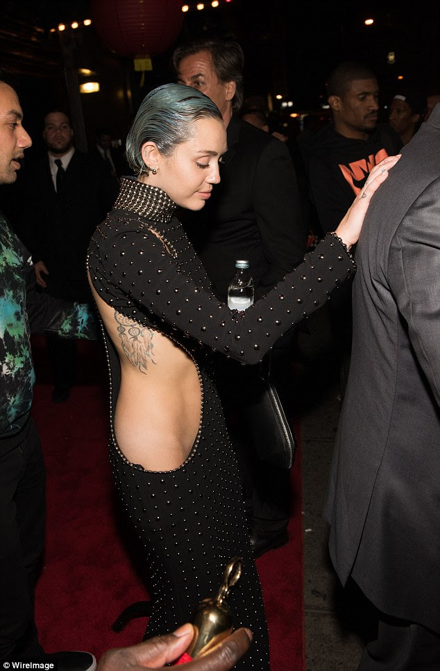 Crikey! Later in the evening, Miley's dress seemed to be even more revealing as she stepped out for Rihanna's private after party at Up & Down in NYC