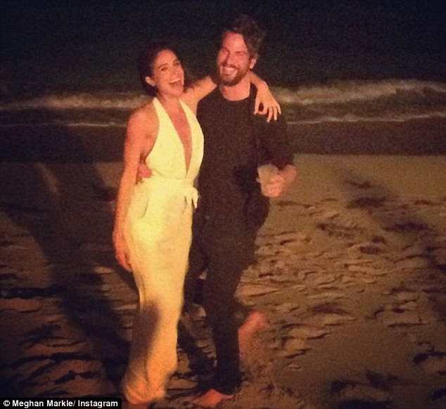 They attended Art Basel in Miami two years ago. In one picture, Meghan and Markus posed in a nighttime shot on the beach with their arms around each other. She wrote: 'Uh oh. Too many fun times with this partner in crime'