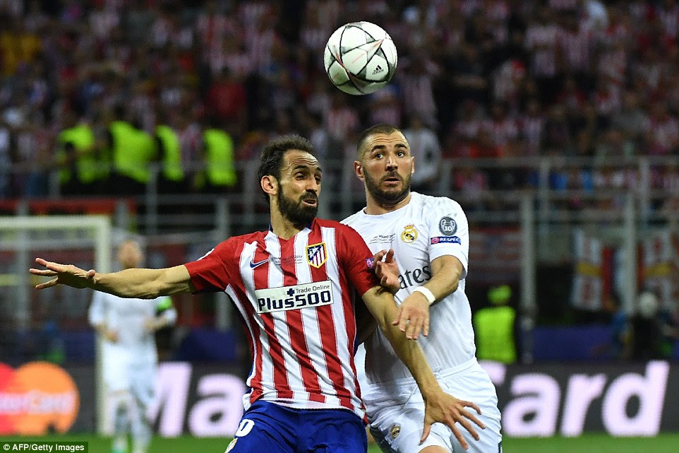 Atletico Madrid defender Juanfran looks to shield the ball from Real striker Karim Benzema during an improved second-half performance