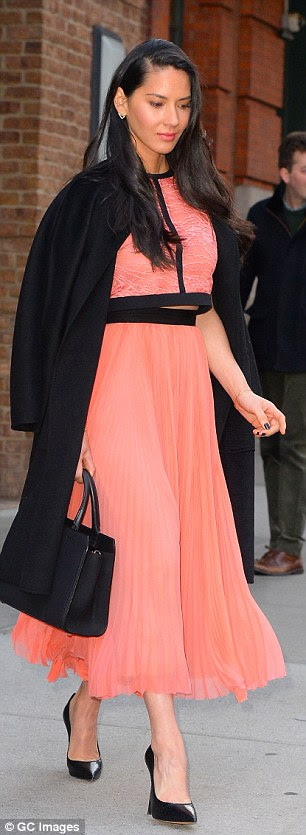 So stylish: The 35-year-old actress stepped out in a peach hued two-pieced dress with floaty pleated skirt