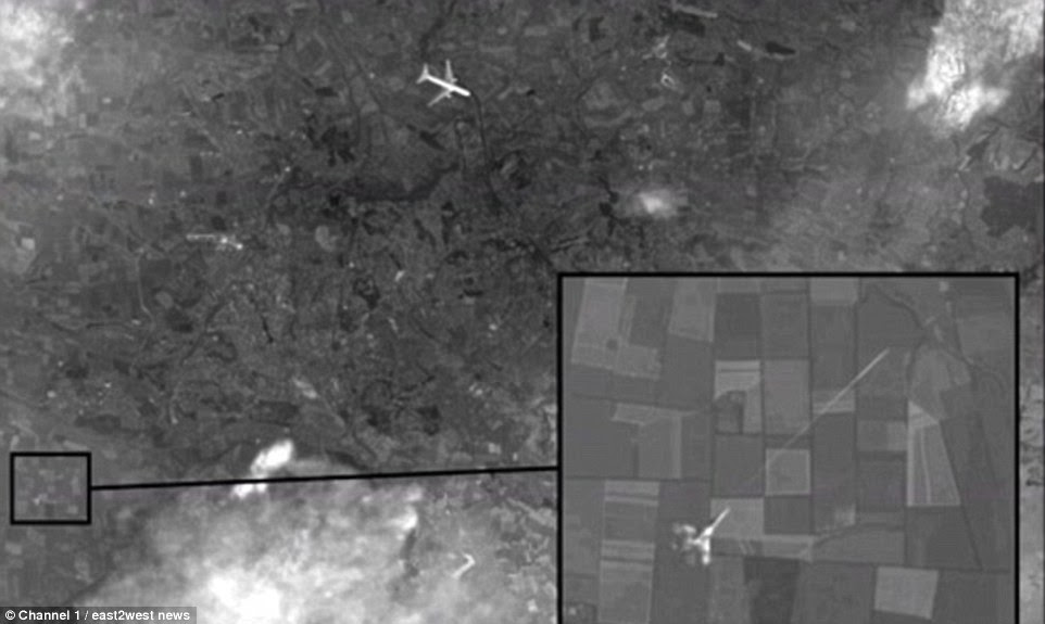 Missing: In November,Russian Channel 1 released satellite images which suggest Malaysian Boeing MH17 (top of picture) was shot down by a Ukrainian warplane (bottom left).It was claimed that the space pictures were from a British or US satellite
