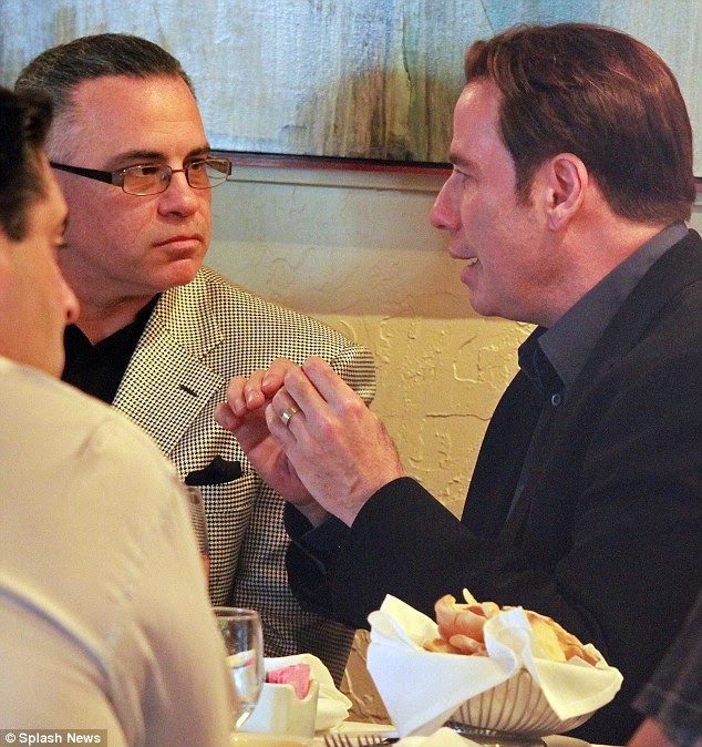 Seeking approval: Travolta explains his plans for the film to an interested Junior Gotti as they talk over dinner