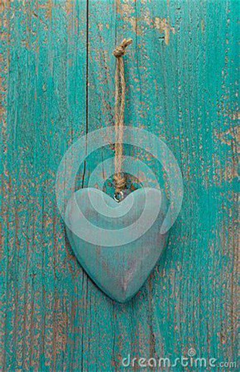 Rustic Heart On Turquoise Wooden Surface For Valentine