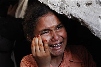 A girl related to two Palestinian militants who were shot by the   Israeli navy cries during their funeral procession Tuesday in Gaza.
