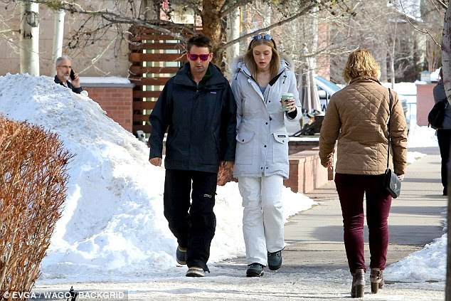 Sweet: Matt Bellamy, 39, and Elle Evans, 28, left the warm tropical waters for a much cooler scene as they enjoyed a brisk walk through snowy Aspen, Colorado, on Wednesday afternoon