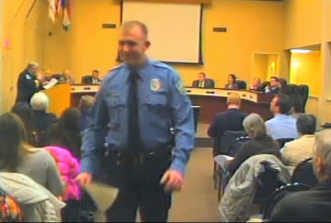 Darren Wilson, the police officer who fatally shot Michael Brown, ata City Council meeting in Ferguson, Mo., in February.