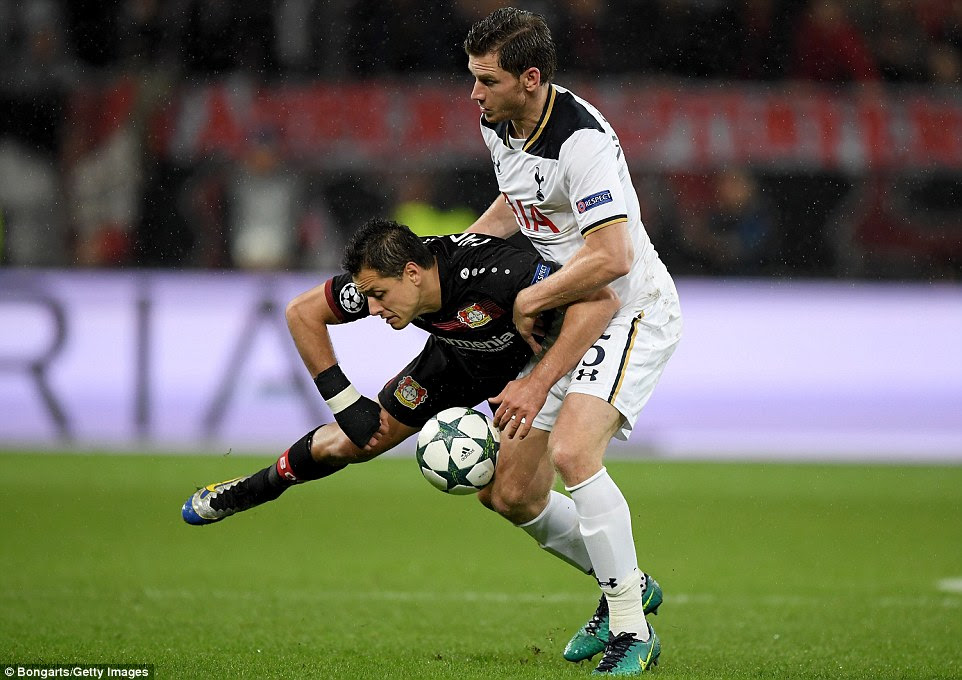 Hernandez goes to ground awkwardly as he crashes into Tottenham's Belgian centre back Jan Vertonghen at the Bay Arena