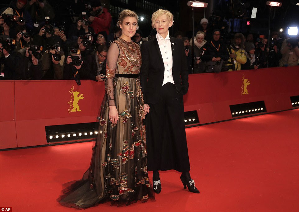 Centre stage: Tilda Swinton also posed for photos with Greta at the star-studded event