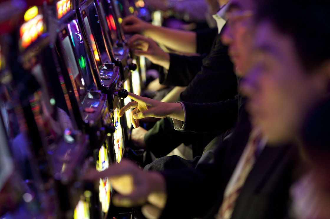 """Japanese businessmen play pachinko after work in Tokyo. Japanese white-collar workers, also known as """"salarymen,"""" increasingly work longer hours because of the fear of losing jobs and a shortage of manpower. Excessive overwork causes depression, and in some cases leads to suicides."""