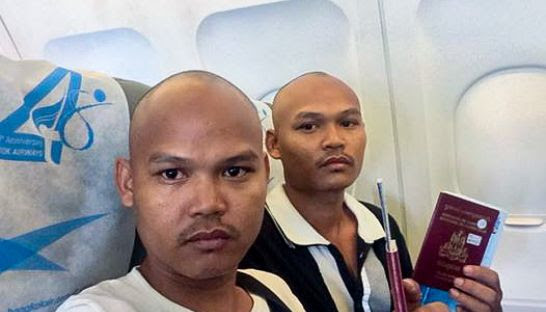 Brothers Chum Huor and Chum Huot pose for a photo on a plane departing the Kingdom earlier this month. Photo supplied