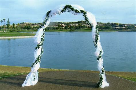 decorating a wedding arbor with tulle How to Decorate a
