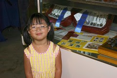 Olivia at County Fair with Panda Stamp Collection