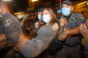 Israeli police use water cannons on protesters, arrest 55