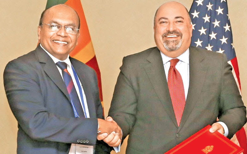 US Ambassador to Sri Lanka and the Maldives Atul Keshap and Civil Aviation Ministry Secretary G.S. Withanage after signing the agreement.