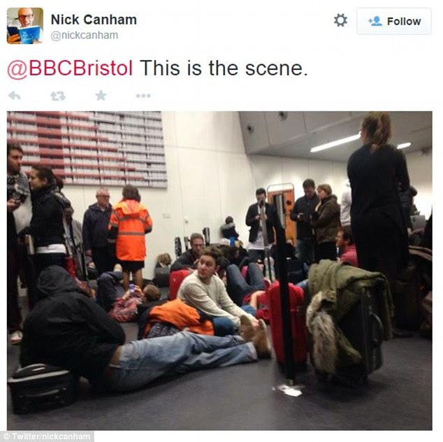 Passengers had to sit on the floor inside the terminal at Amsterdam Schiphol Airport due to limited seating