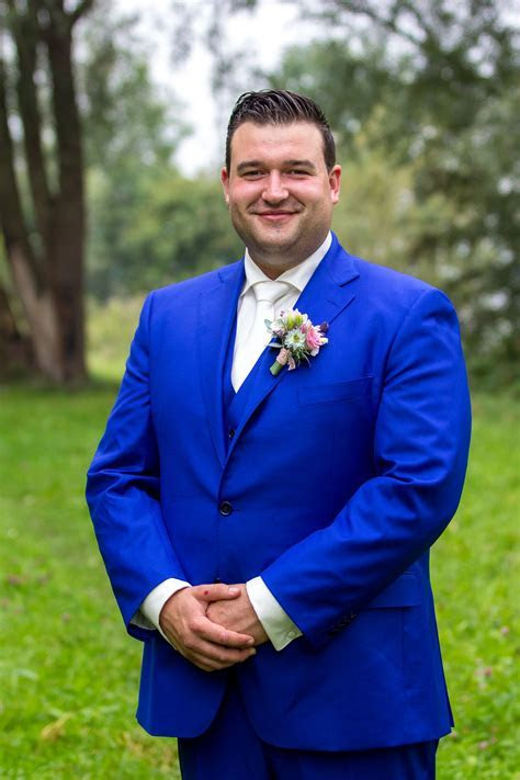 Groom in a Cobalt Blue Suit and an Ivory Tie