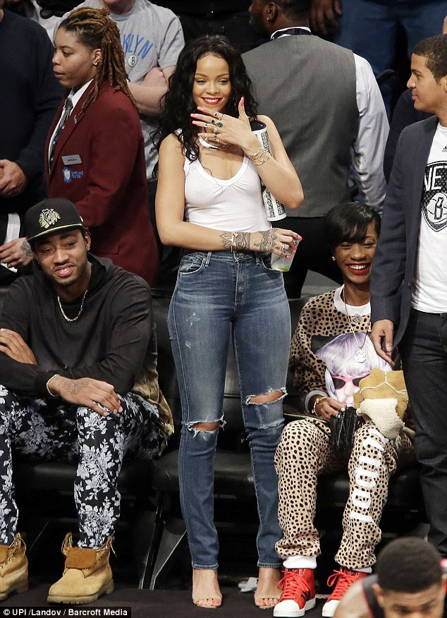 Stylish: Rihanna looked casual and cool in her simple attire, while her pal opted for a leopard-print onesie