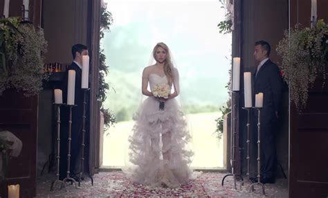 Shakira's wedding dress in Empire video.   Wedding Dresses