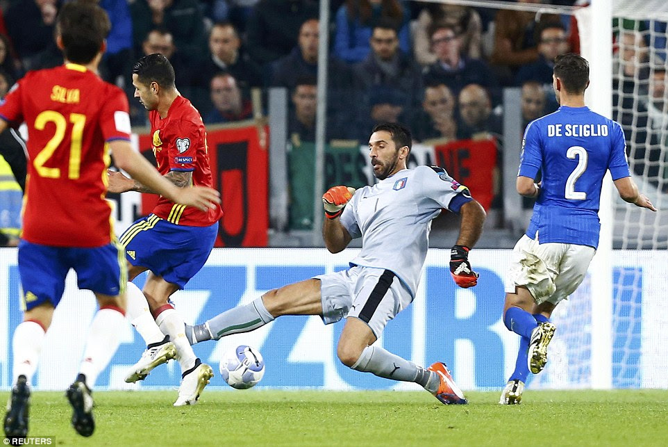 Italy keeper Buffon comes out to close down Vitolo but misses the ball with a lunging tackle outside his area