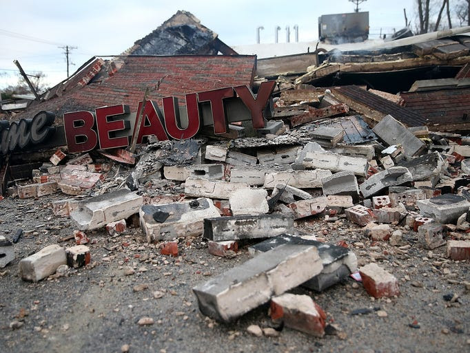 DELLWOOD, MO - NOVEMBER 25:  A sign sits amidst rubble