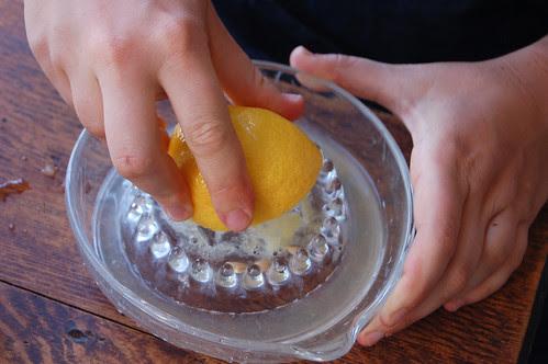 Naushon squeezing lemons