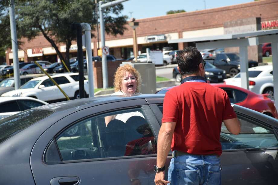 Situations at the pump got tense as drivers began screaming at one another and trying to stop other vehicles from cutting in line Thursday, Aug. 31, 2017. Photo: Caleb Downs
