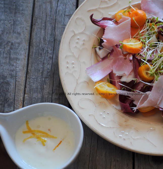 Insalata con kumquat, radicchio rosso e germogli di crescione