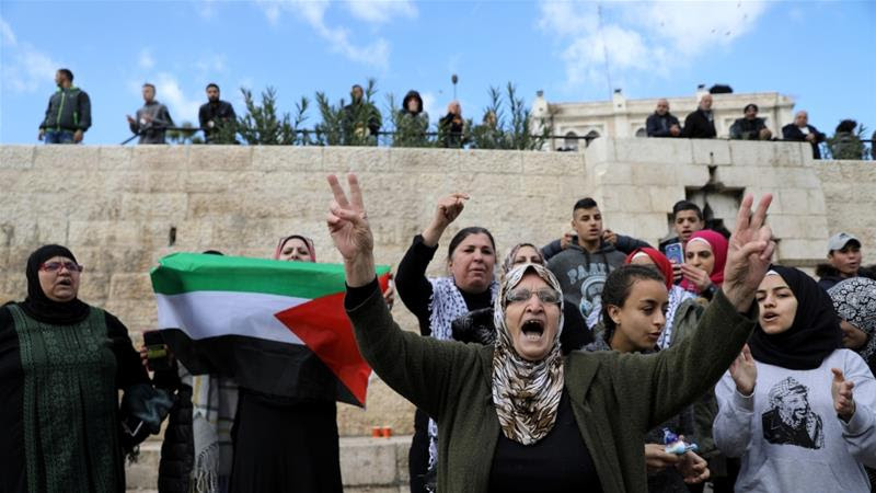 Palestinians shout slogans during a protest following US President Donald Trump's announcement that he has recognised Jerusalem as Israel's capital [Ammar Awad/Reuters]