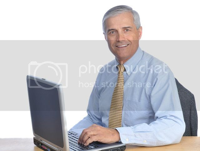 photo bigstock-Middle-Aged-Businessman-Seated-21977048_zps3dce08a2.jpg