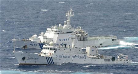 A Chinese marine surveillance cruises next to a Japan Coast Guard patrol ship in the East China Sea, known as the Senkaku isles in Japan and Diaoyu islands in China