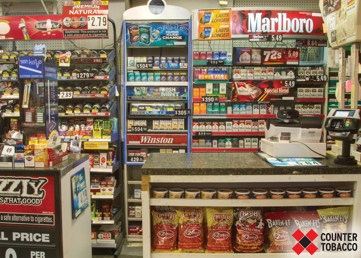 Customer view of tobacco advertising in a typical US convenience store (before).
