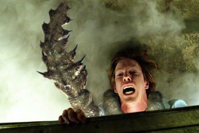 Norm (Chris Owen) is dragged out into The Mist by an unseen tentacled creature.