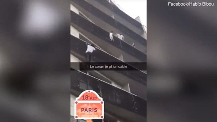 The 22-year-old said he was walking past when he saw the young boy dangling from a fourth storey balcony
