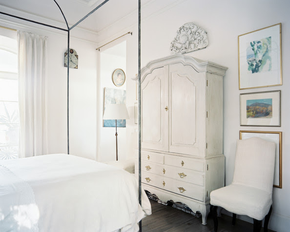 Bedroom - A canopy bed dressed with white linens