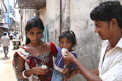 Family Eating Tadgolas by firoze shakir photographerno1