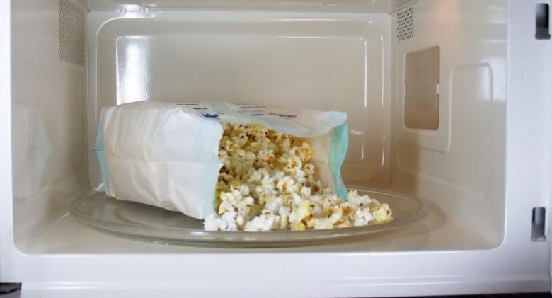 bigstockphoto_Popcorn_In_Microwave_