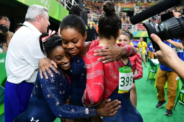 Image result for gabby huging biles