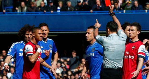 Arsenal's Kieran Gibbs reacts after he is wrongly shown a red card by referee Andre Marriner  during their  Premier League  match against Chelsea at Stamford Bridge. Photograph: Eddie Keogh/Reuters