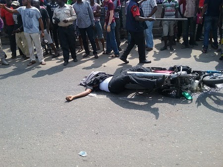 One Dies As Danfo Bus & Okada Rider Collide At Tincan Apapa (See Graphic Photos)
