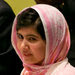 Malala Yousafzai, a Pakistani girl who was shot by the Taliban, was introduced before she spoke to the Youth Assembly at the United Nations in New york on Friday.