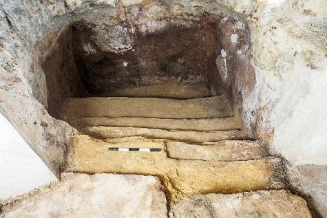 The rock-hewn stairs discovered under the living room floor lead down into the mikvah, the pool of ritual waters, as today.