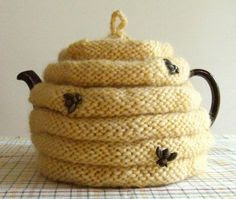 http://www.craftsy.com/pattern/knitting/home-decor/spouted-beehive-tea-cozy/9781.   Love the little bee buttons as well. Pattern on Craftsy.co