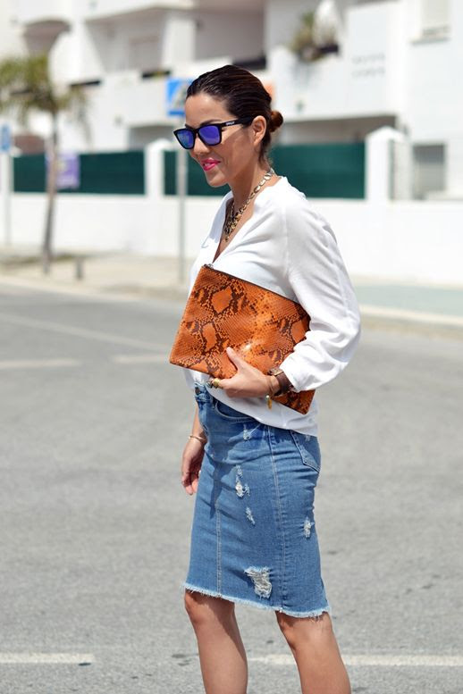 Le Fashion Blog 7 Ways To Style A Distressed Denim Skirt Blogger Con Zapatos Nuevos Low Bun Mirror Sunglasses White Collarless Button Down Shirt Orange Python Snake Clutch Bag Ripped Torn Jean Skirt 5 photo Le-Fashion-Blog-7-Ways-To-Style-A-Distressed-Denim-Skirt-Blogger-Con-Zapatos-Nuevos-5.jpg