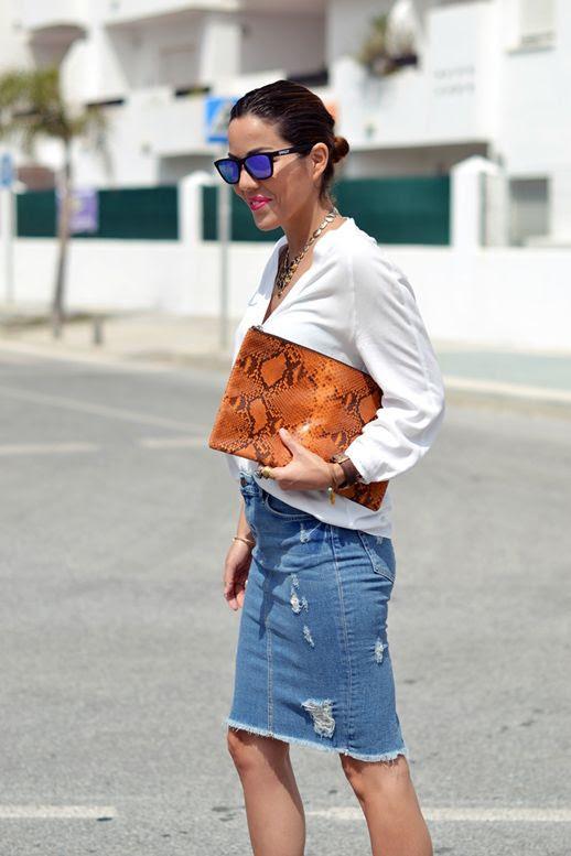 Le Fashion Blog 7 Ways To Style A Distressed Denim Skirt Blogger Con Zapatos Nuevos Low Bun Mirror Sunglasses White Collarless Button Down Shirt Orange Python Snake Clutch Bag Ripped Torn Jean Skirt 5 photo Le-Fashion-Blog-7-Ways-To-Style-A-Distressed-Denim-Skirt-Blogger-Con-Zapatos-Nuevos-5.jpg